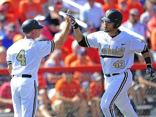 Vanderbilt's Zander Wiel gets a high-five from Coach Tim Corbin for his solo home run in the second inning against Illinois.