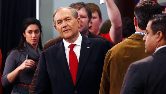 Jim Gilmore walks to the spin room after the Republican undercard debate in Des Moines on Jan. 28, 2016.