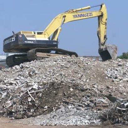 File photo. Yannuzzi crews continue to process debris