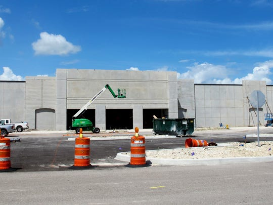 A 55,000-square-foot Hobby Lobby store is under construction Friday, Aug. 6, 2016, behind Outback Steakhouse on U.S. 41 East in East Naples.