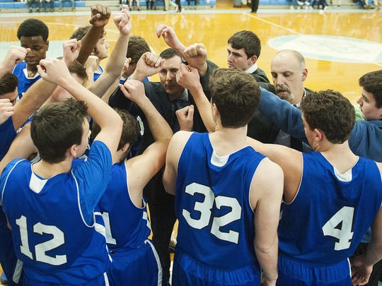 Colchester huddles together during the boys basketball game between the Colchester Lakers and the South Burlington Rebels at South Burlington High School on Saturday afternoon.