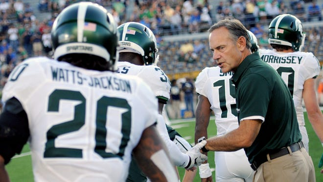 Michigan State Spartans head coach Mark Dantonio shakes hands with his players before the game against Notre Dame on Saturday, Sept. 17, 2016 in South Bend, Indiana.