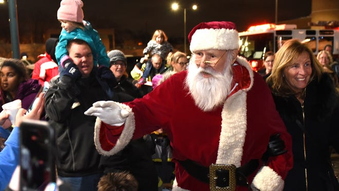 Santa Claus welcomes visitors to Redford's Olde-Fashioned Holidays event on Thursday.