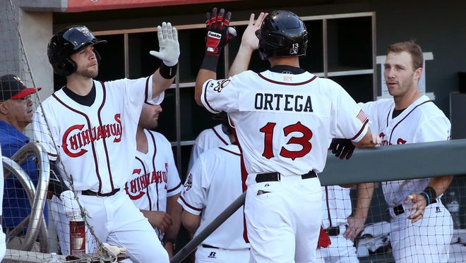 Chihuahuas designated hitter Christian Villanueva, 13, heads to the dugout after hitting a one run home run early in the game against the Tacoma Rainiers Tuesday night.