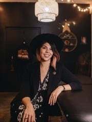 Hand-poke tattoo artist Taylor Elyse Compton in her Yucca Valley studio