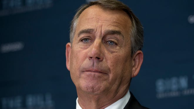 House Speaker John Boehner of Ohio pauses  during a news conference on Capitol Hill in Washington, Wednesday, Oct. 21, 2015.