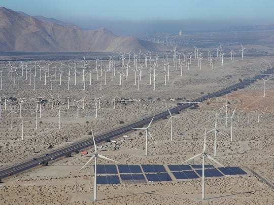 Wind turbines and solar panels dominate the landscape along Interstate 10 near Palm Springs, California.