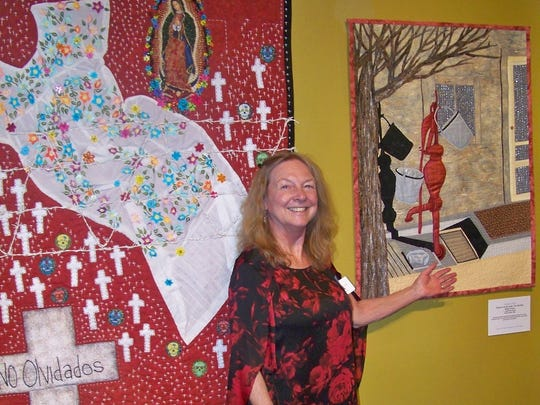 """Fiber artist Jodie Mc Lemore with her quilt """"Oracle of Arid Land."""""""