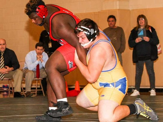 Manville High School's Michael Tyle (gold singlet)