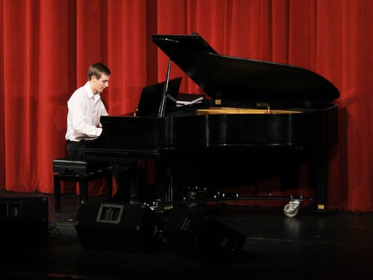 Silverton High School student Matthew Edmonds performs on the piano during the school's fourth annual Cabaret on March 16.