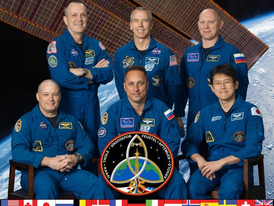 The official portrait for the the Expedition 55 crew.