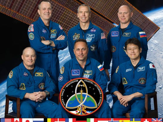 The official portrait for the the Expedition 55 crew. Front row, left to right: Scott Tingle of NASA, Commander Anton Shkaplerov of Roscosmos and Norishige Kanai of the Japan Aerospace Exploration Agency. Back row, left to right: NASA astronauts Ricky Arnold and Andrew Feustel and Roscosmos cosmonaut Oleg Artemyev.