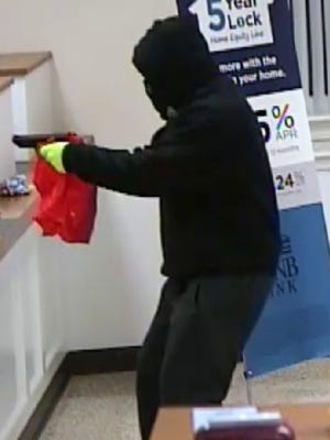Police are searching for a male suspect in an armed robbery at Adams County National Bank that took place on February 2, 2018.