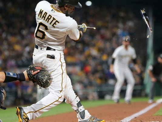 Pittsburgh Pirates' Starling Marte's bat shatters as he hits a fly ball for an out against the San Diego Padres in the fifth inning of a baseball game, Friday, Aug. 4, 2017, in Pittsburgh. (AP Photo/Keith Srakocic)
