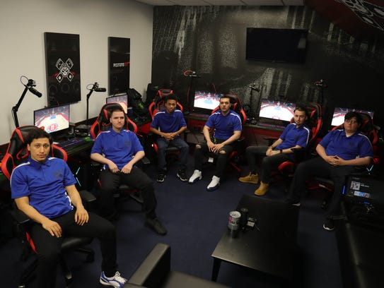 The Pistons NBA 2K team, from left, Fred Mendoza, 25,