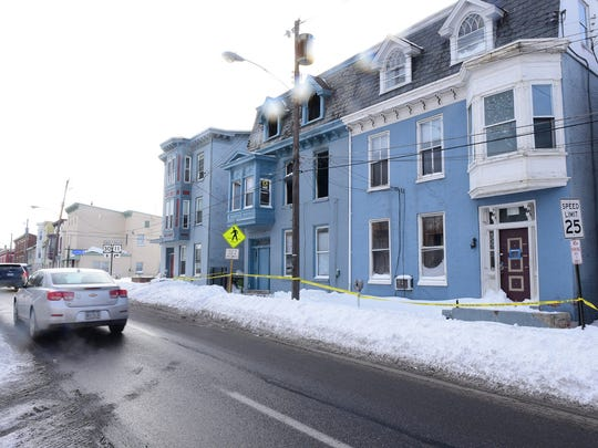 An apartment building at 60 West Queen Street, photographed Monday, Jan. 25, 2016, was damaged during a fire Sunday night in Chambersburg.