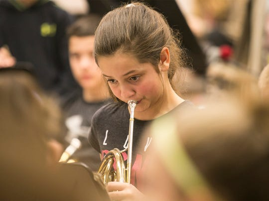 "Sixth-grader Gracie Shaub, plays her french horn during band class Wednesday, March 16, 2016, at Spring Grove Intermediate School. The fifth- and sixth-grade band, will play ""Tears of Arizona"" publicly for the first time during a concert, held at the school on March 31, and then again in Washington D.C in May. Amanda J. Cain photo"
