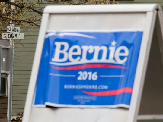 A signboard announces the presence of the Ithaca Bernie Sanders campaign headquarters in the Clinton West Plaza on W. Clinton Street in Ithaca.