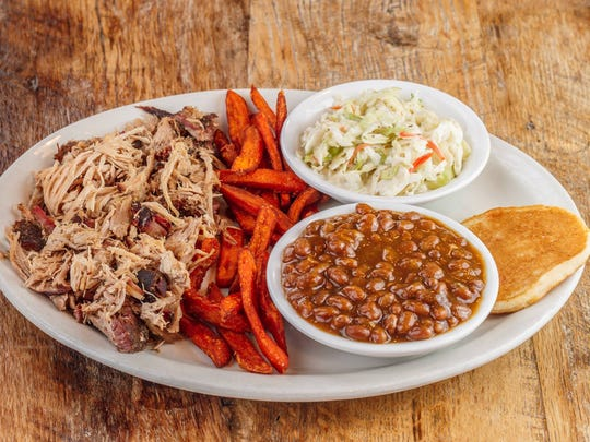 Chalkboard meat-and-three plate specials are available