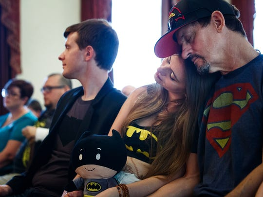 Jennifer Leonhard is consoled by her father, Kevin Morrison during the funeral for her son William Leonhard on Saturday, July 16, 2016 in Des Moines. He was stillborn to his parents who wanted the cosplay community to come and help them celebrate.