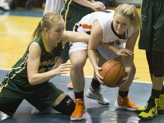 Central York's Nikki Valencik, right, fights for the