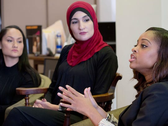 Women's March officers Tamika Mallory, right, and Carmen Perez, left, have been accused of anti-Semitism. Fellow co-founder Linda Sarsour is in the middle.