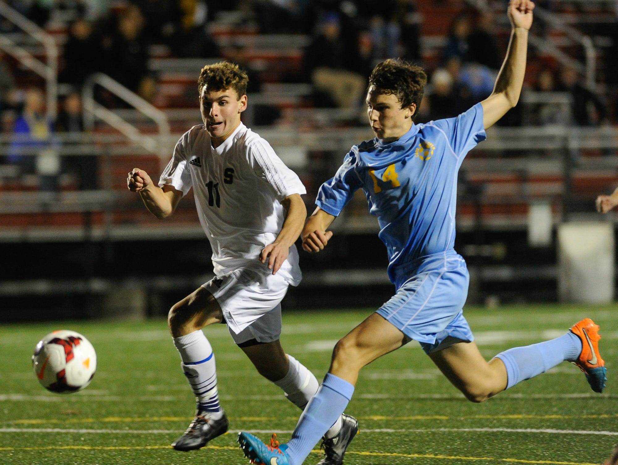 Salesianum's #11 Trevor Clare and Cape Henlopen's #14 Zachary Gelof run for the ball in the second half of the DIAA Division I soccer semifinal game at Smyrna High School.
