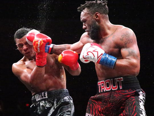 Austin Trout, right, lands a punch at Juan De Angel