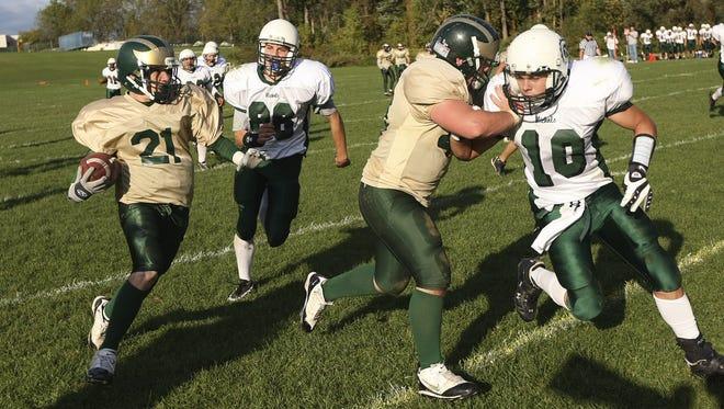 2008 file photo: Finney running back Andrew Morgante (21) follows the block of teammate Ed Marchand on Nichols' Aandrew Toenniessen (10).
