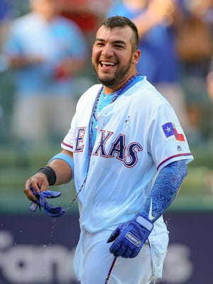 Texas Rangers catcher Jose Trevino (71) is doused after his walk-off single against the Colorado Rockies at Globe Life Park in Arlington.