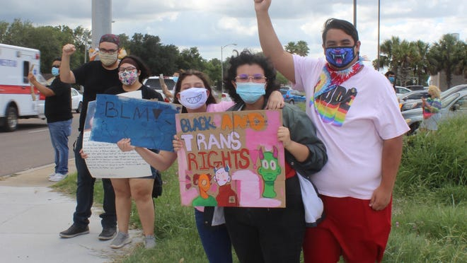 Protesters in Alice took to their signs to spread awareness about racial inequality.