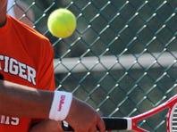 Albert Go of Merritt Island returns a shot during Tuesday's District tennis tournament in Titusville.