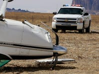 A small passenger plane sits off the runway after being flipped by the wind on Thursday at the Shiprock Airstrip.