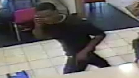 Police are looking for this man who stole a handgun from the back pocket of another man ordering food at McDonald's.