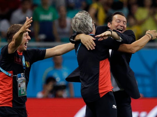 Belgium's head coach Marc Wilmots, right,  celebrates with his staff after the World Cup round of 16 soccer match between Belgium and the USA at the Arena Fonte Nova in Salvador, Brazil, Tuesday, July 1, 2014. Belgium won the match 2-1 after extra-time. (AP Photo/Matt Dunham)