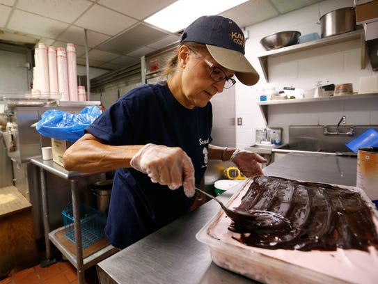 Kim Robertson, owner of Bauder's Ice Cream, spreads