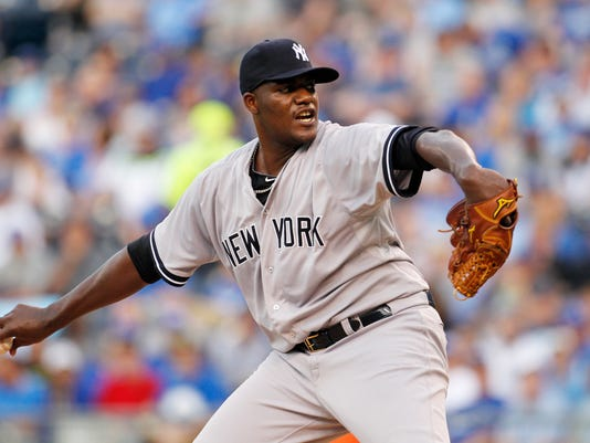 New York Yankees pitcher Michael Pineda throws in the first inning of a baseball game against the Kansas City Royals at Kauffman Stadium in Kansas City, Mo., Friday, May 15, 2015. (AP Photo/Colin E. Braley)