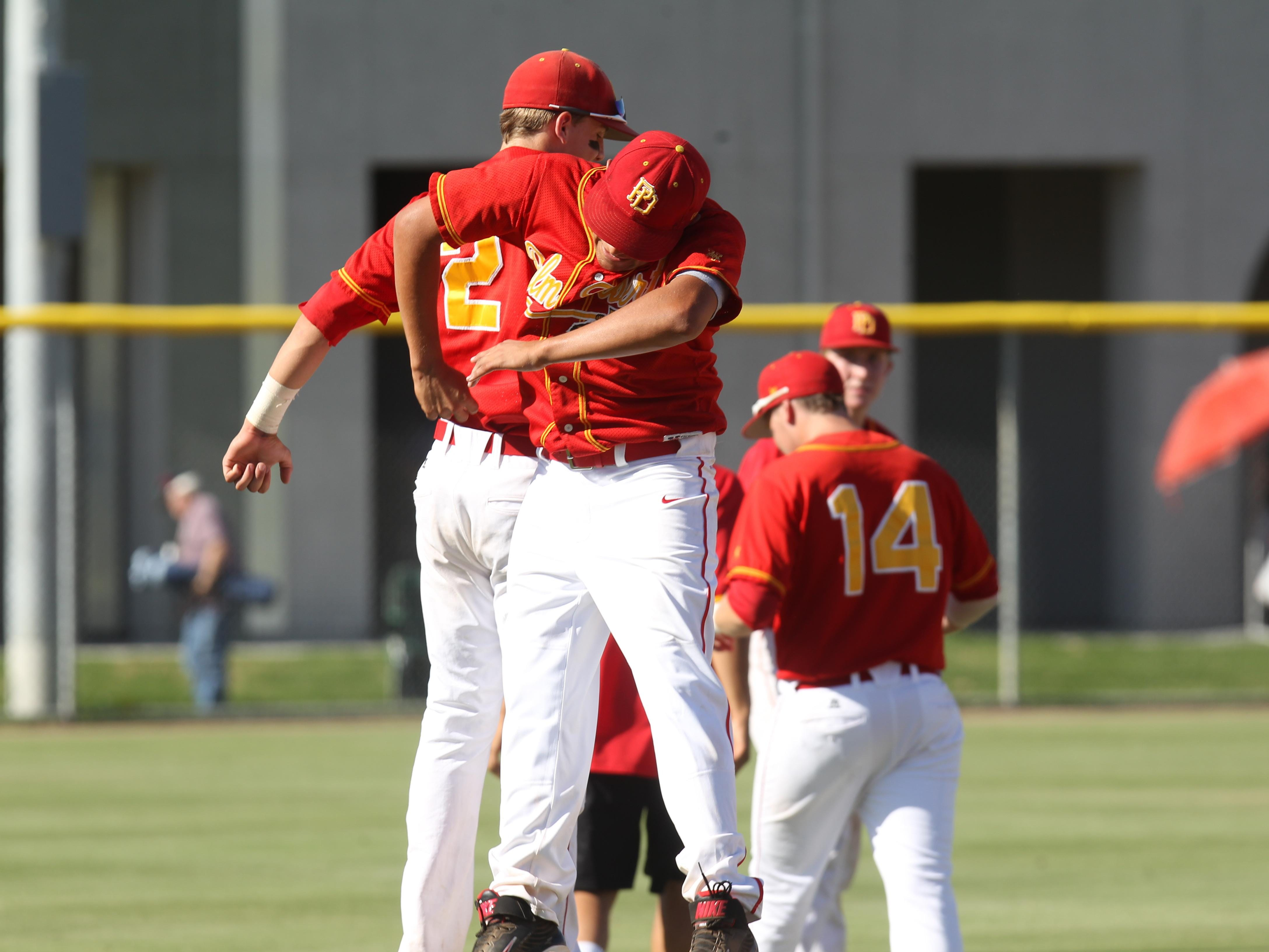 Palm Desert's (from left) Travis Moniot and Josh Burke celebrate a CIF win against Santa Monica at Palm Desert High School June 3, 2014.