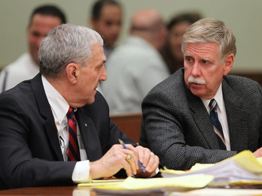 Former Greece Police Chief Merritt Rahn talks to his lawyer, John Parrinello before being found guilty on 7 counts in Rochester, NY on Thursday, April 29, 2010.