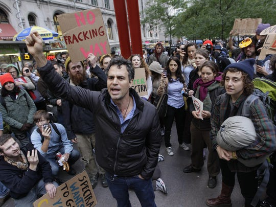 Actor Mark Ruffalo (center) speaks to demonstrators