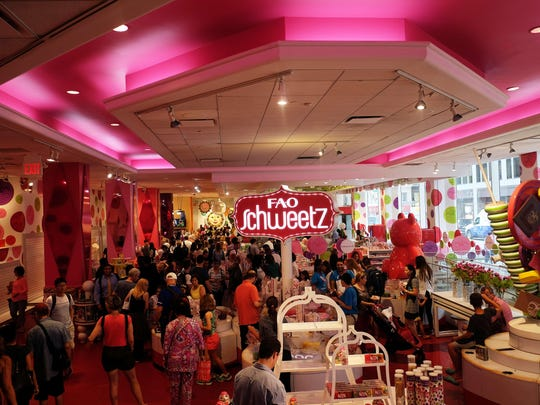 People wander inside FAO Schwarz in New York during its last day in business on July 15, 2015.