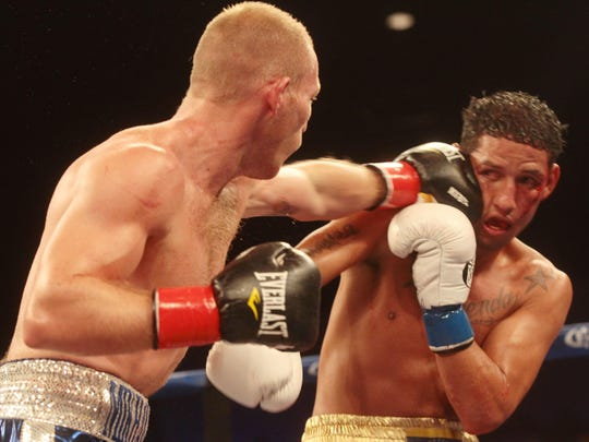 At left Russian Dmitry Mikhaylenko lands hard shots on Johan Perez of Venezuela. Mikhaylenko defeated Perez on a stoppage on the 8th round and is the new NABA Welterweight Champion.