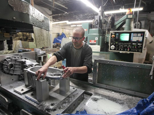 Mike McNerney of Rochester sets up a milling machine