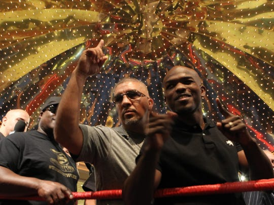 "WBO Light Welterweight Champion Timothy Bradley Jr. makes his ""grand entrance"" at the MGM Grand as part of fight week in Las Vegas, Nevada to promote his fight against Manny Pacquiao. At left is Joel Diaz, trainer of Bradley."