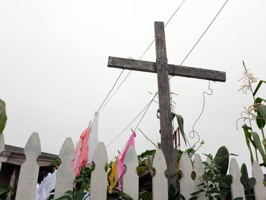 A front-yard cross doubles as a laundry line on Pacific Avenue in Salinas.