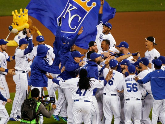 Kansas City Royals players celebrate on the field after their 7-2 win over the Houston Astros in Game 5 of baseball's American League Division Series, Wednesday, Oct. 14, 2015, in Kansas City, Mo.  (AP Photo/Colin E. Braley)