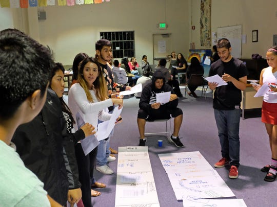 At a meeting on Monday, Ciclovia Salinas volunteers at the Alisal Center for the Fine Arts work out route logistics for the upcoming youth-led event on Sunday.