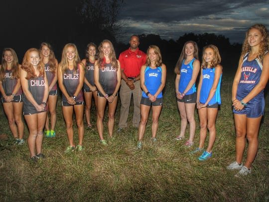2015 All-Big Bend girls cross country team. L-R: Erin Phelps (Chiles), Emily Culley (Chiles), Alexandra Wallace (Chiles), Olivia Miller (Chiles), Ana Wallace (Chiles), Runner of the Year Emma Tucker (Chiles), Coach of the Year Tyrone McGriff (Florida High), Caroline Willis (Maclay), Molly McCann (Maclay), Lindsay James (Maclay) and Haleigh Martin.