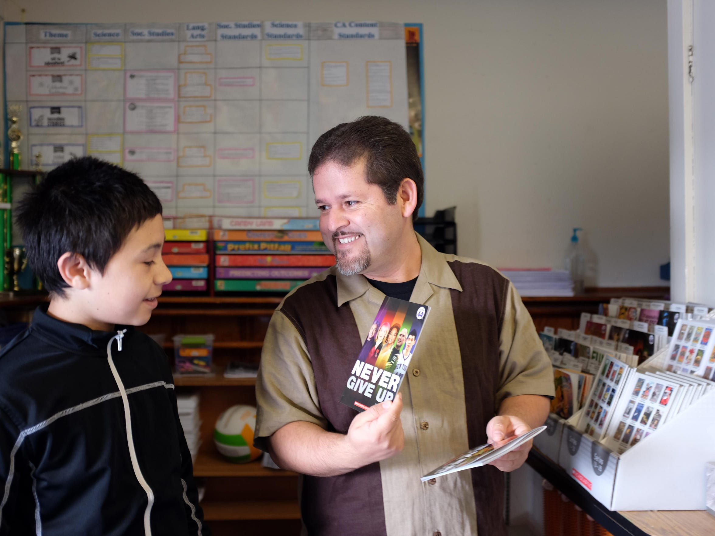 A December 2015 photo of Sherwood Elementary School teacher Oscar Ramos with José Anzaldo in Salinas, in Mr. Ramos' classroom where José was a student.