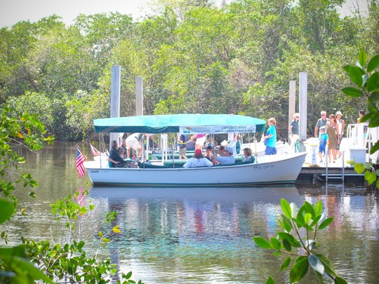 Attendees of the Earth Day Festival at the Conservancy of Southwest Florida can take electric boat rides on the Gordon River.